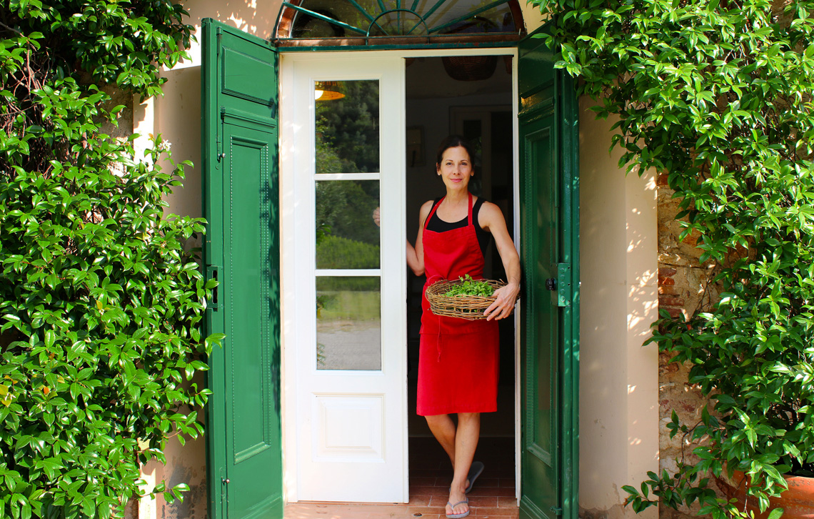Italian Chef Deborah Dal Fovo at her kitchen door in Tuscany